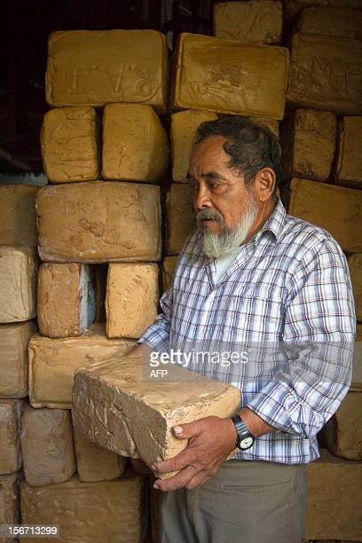 The president of the cooperative Tres Garantias Raymundo Terron loads a pack of base of gum in a cellar in Tres Garantias Quintana Roo State Mexico...