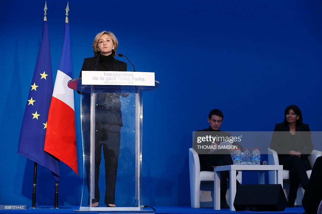 The president of the Council of the Ile-de-France region Valerie Pecresse (L) delivers a speech, next to French Prime minister Manuel Valls (C) and Paris Mayor Anne Hidalgo (R), during the inauguration of the new Rosa Parks railway station in Paris on February 6, 2016. / AFP / THOMAS SAMSON