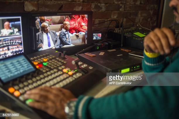 The president of the Economic Freedom Fighters Julius Malema is seen on a control screen as he attends a hearing brought by opposition parties...