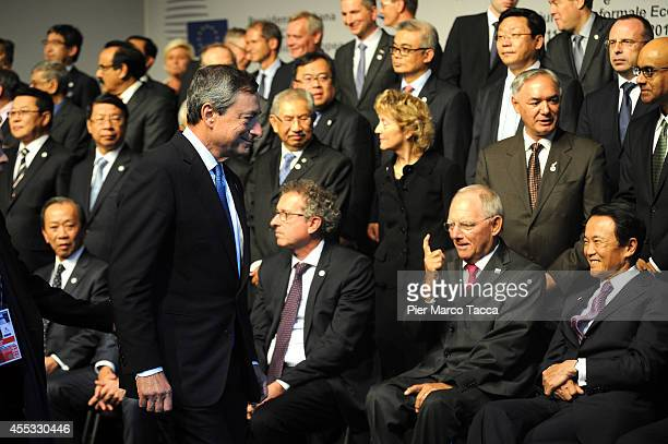 The President of the European Central Bank Mario Draghi German Finance Minister Wolfgang Schauble and The Minister of Finance of JapanTaro Aso attend...