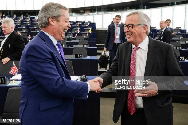 The President of the European Commission JeanClaude Juncker shakes hand with Member of the European Parliament and former leader of the antiEU UK...
