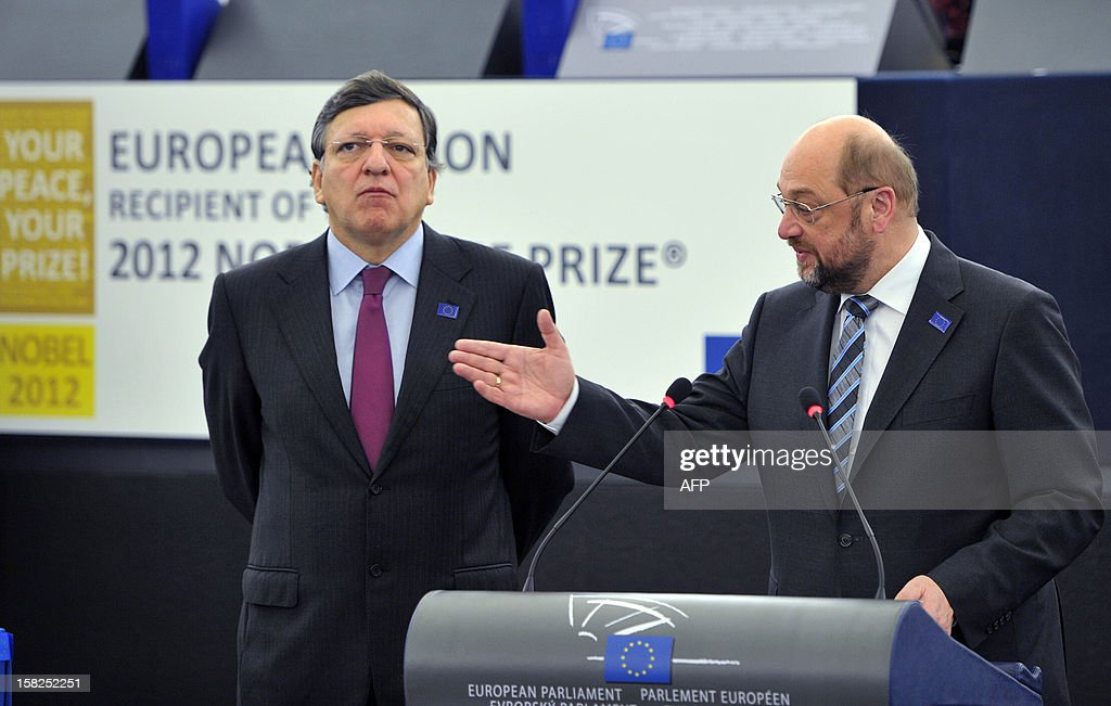 The President of the European Commission Jose Manuel Barroso (L) and the President of the European Parliament Martin Schulz attend a ceremony to celebrate this year's Nobel Peace Prize laureate, the European Union (EU), at the European Parliament in Strasbourg, eastern France, on December 12, 2012. Nobel Peace Prize in hand, European leaders meet for a final 2012 summit on December 13, 2012 still facing the uncertainties of the debt crisis and with unsettled Italy back in the spotlight. AFP PHOTO