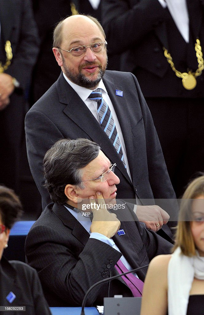 The President of the European Commission Jose Manuel Barroso (bottom) and the President of the European Parliament Martin Schulz attend a ceremony to celebrate this year's Nobel Peace Prize laureate, the European Union (EU), at the European Parliament in Strasbourg, eastern France, on December 12, 2012. Nobel Peace Prize in hand, European leaders meet for a final 2012 summit on December 13, 2012 still facing the uncertainties of the debt crisis and with unsettled Italy back in the spotlight.