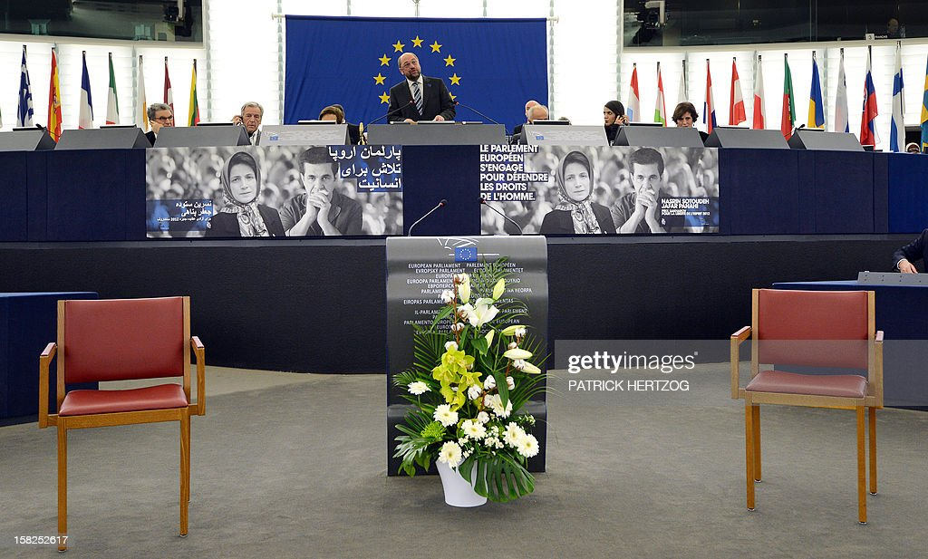 The President of the European Parliament Martin Schulz (C) speaks during a ceremony awarding the Sakharov Prize for freedom of thought to Iranian activists, lawyer Nasrin Sotoudeh and film director Jafar Panahi, at the European Parliament in Strasbourg, eastern France, on December 12, 2012. The laureates were not able to attend the ceremony as they were not allowed to leave Iran.