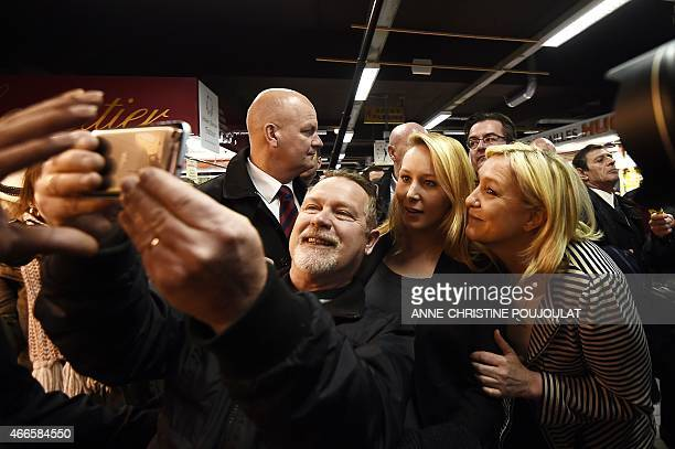 The president of the farright National Front party Marine Le Pen poses for a photo on March 17 2015 with FN Vaucluse deputy Marion Marechal Le Pen at...