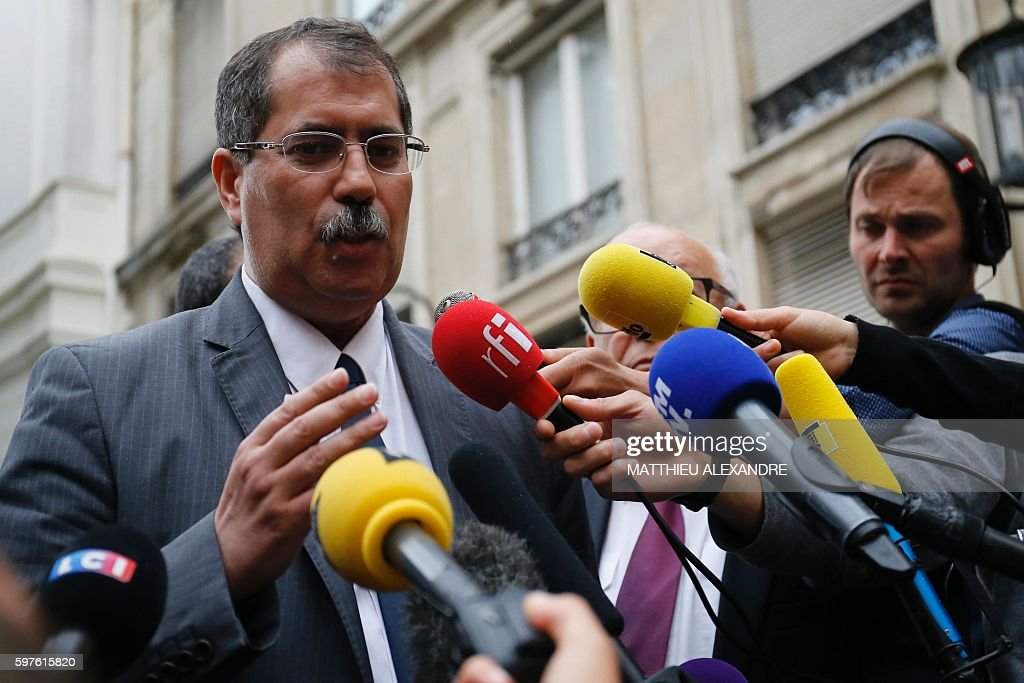 The president of the French Council of the Muslim Faith Anouar Kbibech speaks to journalists after a meeting with Interior Minister and...
