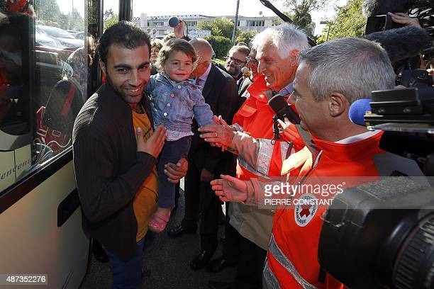 The President of the French Red Cross JeanJacques Eledjam and members of the French Red Cross welcome some of the ninetythree Syrian Eritrean and...