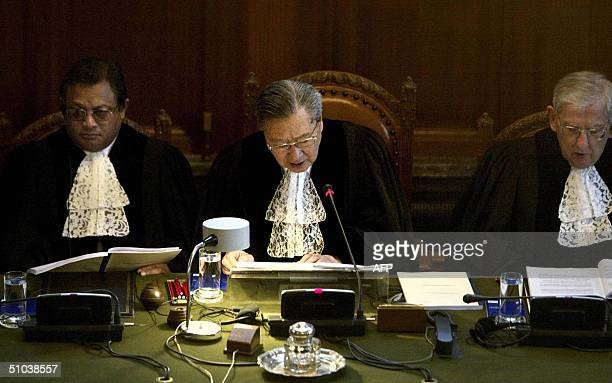 The president of the International Court of Justice Shi Liuyong reads aloud the court ruling about the Israeliconstructed West Bank barrier 09 July...