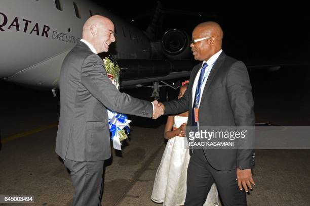 The president of the International Federation of Association Football Gianni Infantino is welcomed by the president of the Federation of Uganda...
