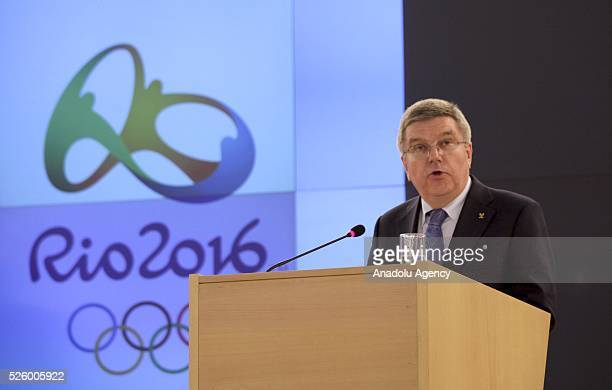 The President of the International Olympic Committee Thomas Bach delivers a speech during the ceremony of receiving the Olympic torch at the UN...