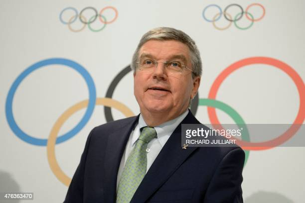 The President of the International Olympic Committee Thomas Bach speaks to the media at the end of an IOC Executive Board meeting in Lausanne on June...
