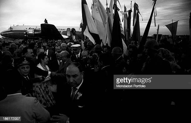 The President of the Italian Republic Giovanni Gronchi is welcomed by a sea of people at Buenos Aires airport Ministro Pistarini during his visit to...