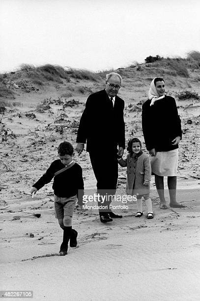 The President of the Italian Republic Giuseppe Saragat holding by the hand his Italian granddaughter Giuseppina Santacatterina His Italian grandson...
