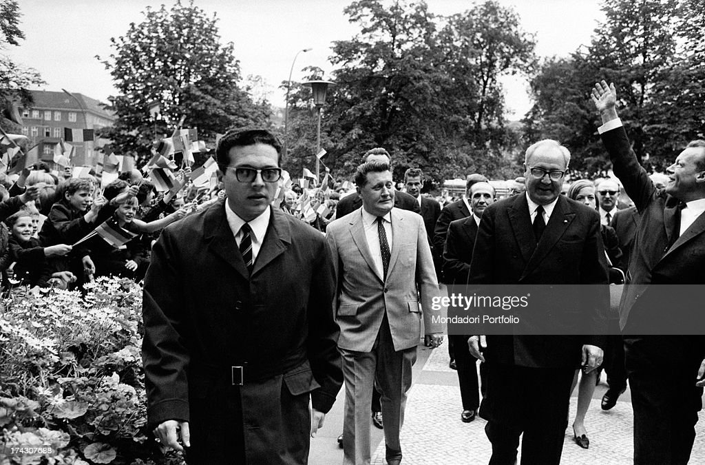 The President of the Italian Republic Giuseppe Saragat smiling at the crowd during a diplomatic journey. Germany, July 1965.