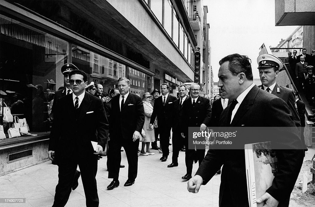 The President of the Italian Republic Giuseppe Saragat watching West Berlin from a terrace. German mayor of the city Willy Brandt (Herbert Frahm) accompanying him.. Berlin, July 1965.