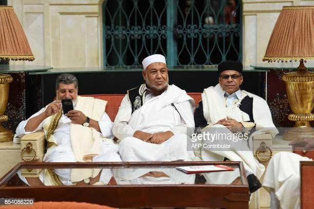 The president of the Libyan supreme council of reconciliation Mohamed Allouch wait along with tribal leaders for the start of a meeting with rival...