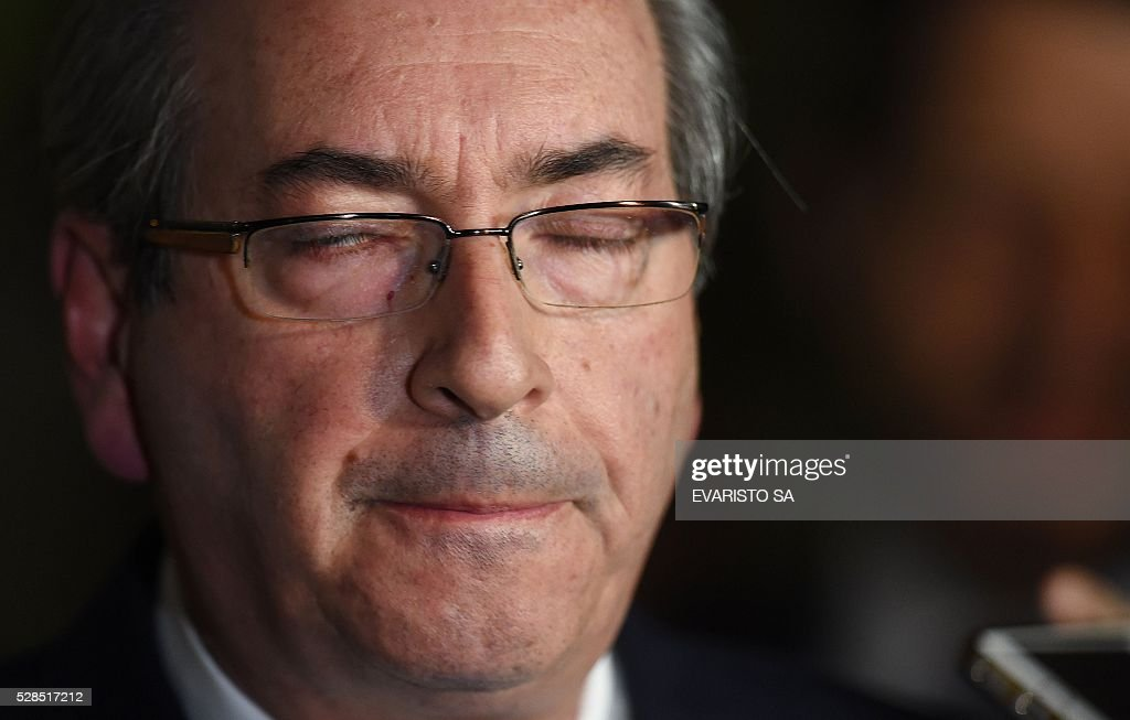 The president of the Lower House, Eduardo Cunha, gestures during a press conference at the Lower House's official residence in Brasilia on May 5, 2016. Brazil's Supreme Court on Thursday suspended Eduardo Cunha, the powerful lawmaker at the centre of efforts to impeach President Dilma Rousseff, on grounds he tried to obstruct a probe into his alleged corruption. The speaker of Brazil's lower house of Congress is the architect of the impeachment drive expected to force Rousseff to step aside from office on Wednesday. SA