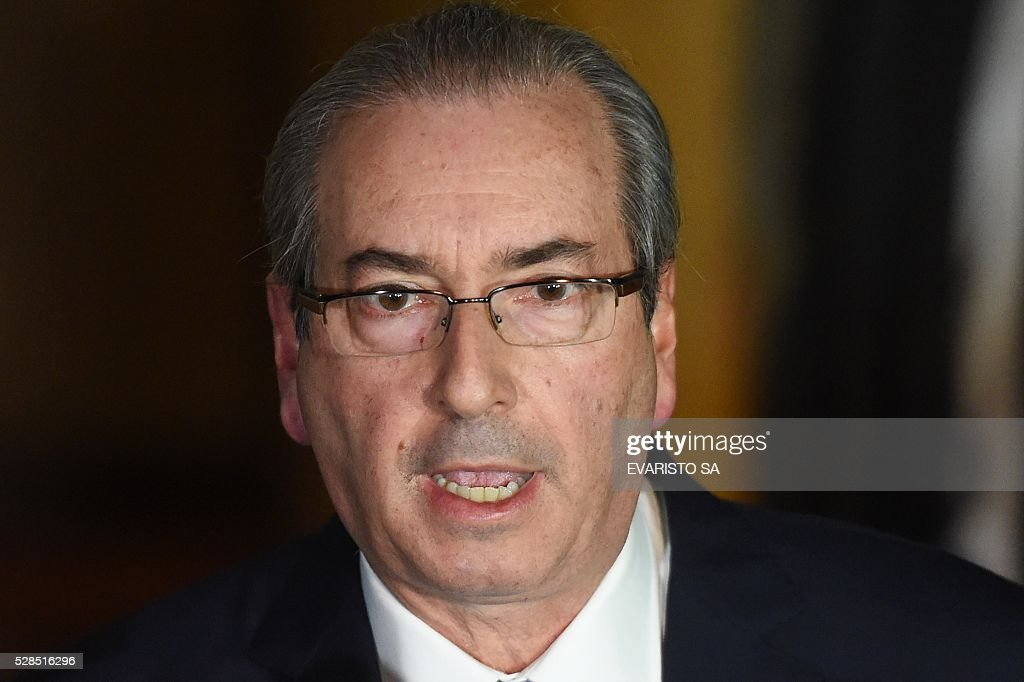 The president of the Lower House, Eduardo Cunha, speaks to the press at the Lower House's official residence in Brasilia on May 5, 2016. Brazil's Supreme Court on Thursday suspended Eduardo Cunha, the powerful lawmaker at the centre of efforts to impeach President Dilma Rousseff, on grounds he tried to obstruct a probe into his alleged corruption. The speaker of Brazil's lower house of Congress is the architect of the impeachment drive expected to force Rousseff to step aside from office on Wednesday. SA