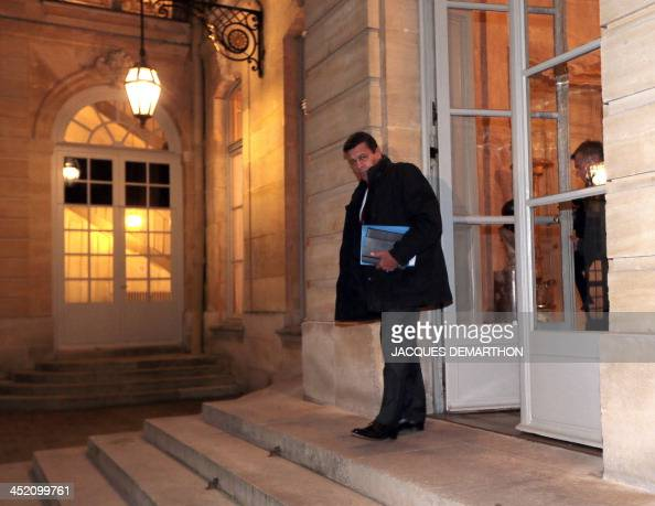 The president of the main French agricultural trade union FNSEA Xavier Beulin leaves after meeting French Prime Minister as part of talks over the...