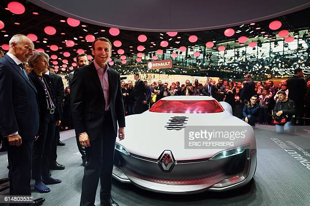 The president of the movement 'En Marche' Emmanuel Macron looks at a Renault concept car during his visit of the Paris Motor Show at the Porte de...