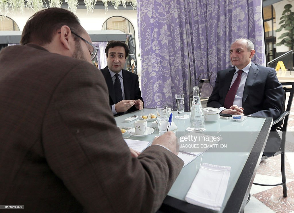 The president of the Nagorny Karabakh region's unrecognised government, Bako Sahakian (R), flanked by Hovhannes Guevorkian (C), representative of the High Karabakh, are seen during an interview on April 26, 2013 during their three-day visit in Paris. The international community must take Azerbaijan's threats of regaining the disputed region of Nagorny Karabakh seriously and condemn Baku's ongoing arms-buying spree, the breakaway territory's leader said Friday.