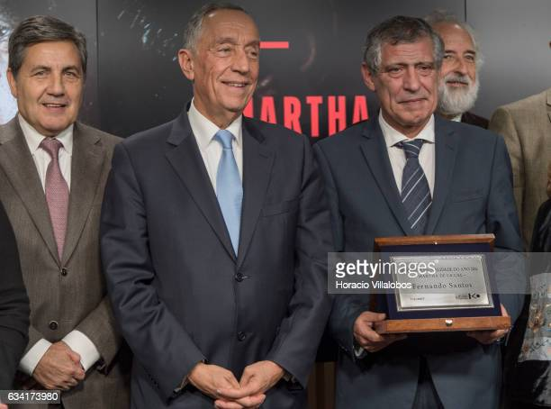 The president of the Portuguese Soccer Federation Fernando Soares Gomes da Silva and Portuguese President Marcelo Rebelo de Sousa accompany a deeply...