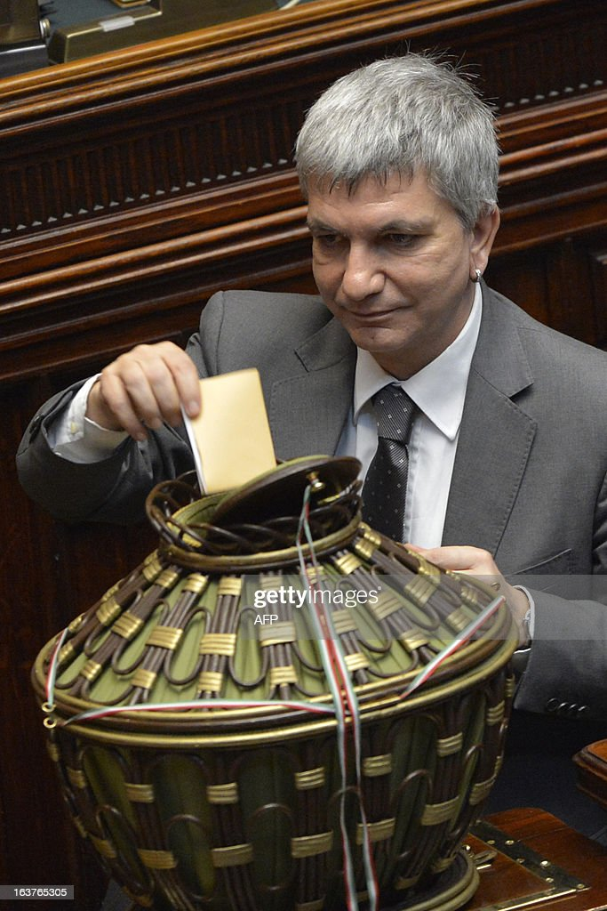 The President of the Puglia region and head of a small left-wing party Nichi Vendola casts his ballot during the first session of Italian lower-house on March 15, 2013 in Rome. General election in Italy took place on February 26 but as a majority in both chambers of parliament is required to form a government, Italy is left in a state of limbo with a hung parliament that is unprecedented in its post-war history.
