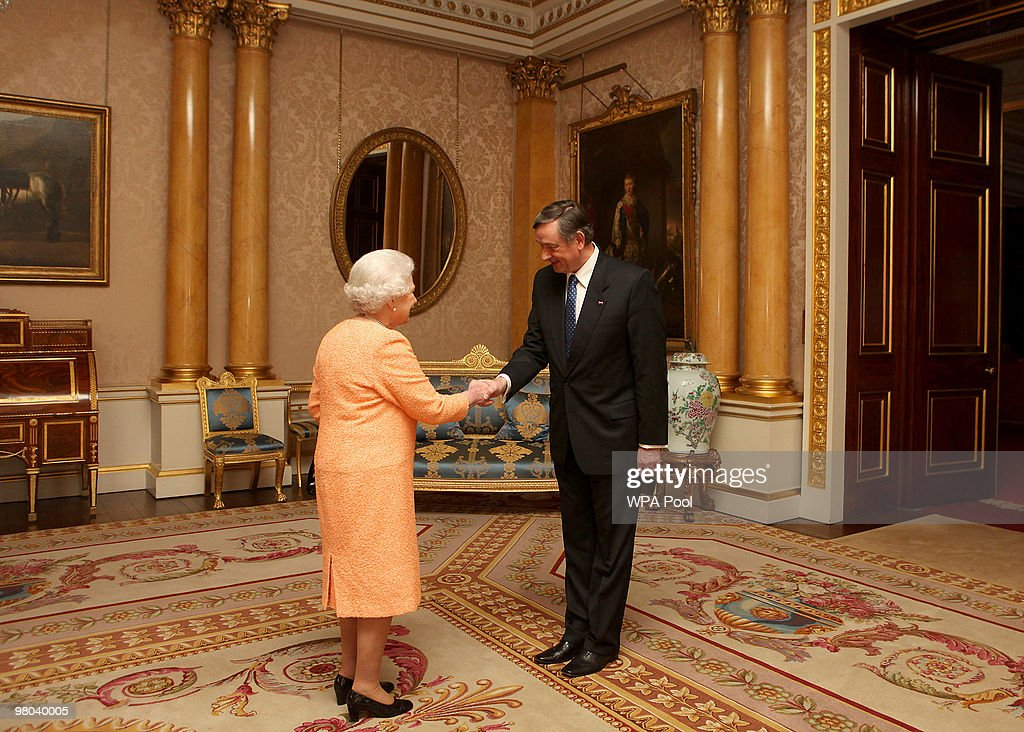The President of the Republic of Slovenia, Dr Danilo Turk, greets Britain's Queen Elizabeth II during a visit to Buckingham Palace on March 25, 2010 in London, England.