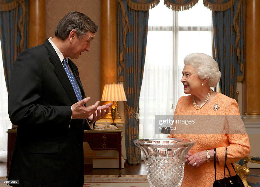 The President of the Republic of Slovenia, Dr Danilo Turk, presents Britain's Queen Elizabeth II with Rogaska Crystal during a visit to Buckingham Palace on March 25, 2010 in London, England.