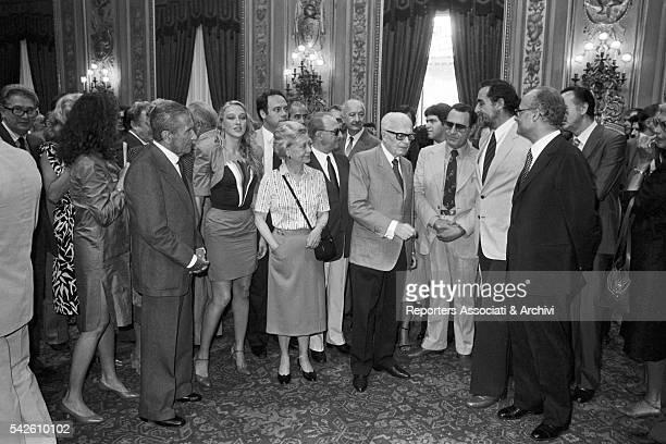 The President of the Republic Sandro Pertini receiving at the Quirinal Italian actors Giulietta Masina Vittorio Gassman and Alberto Sordi Rome 1982