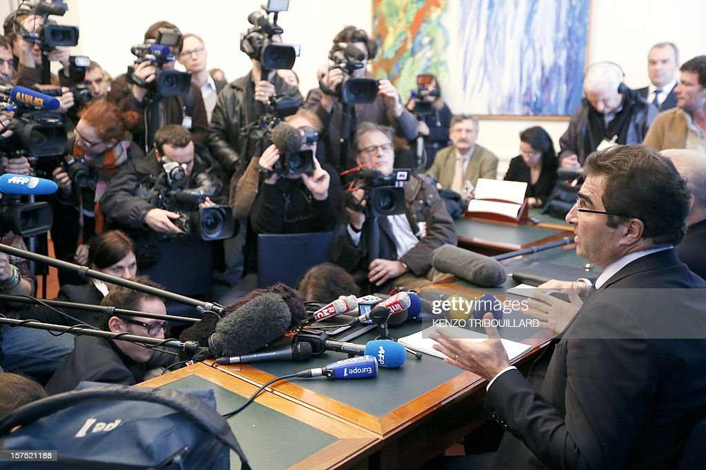 The president of the right-wing opposition UMP group at the National Assembly, Christian Jacob (R) gives a press conference on December 4, 2012 at the French National Assembly in Paris.