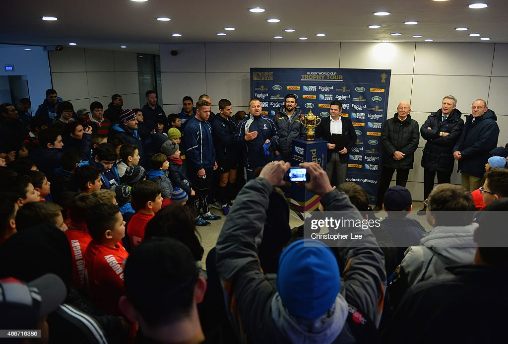The President of the Romanian Rugby Federation Harry Dumitras with members of the Romanian Rugby Team talk to young fans with the Webb Ellis Cup during the Rugby World Cup Trophy Tour in partnership with Land Rover and DHL ahead of Rugby World Cup 2015 on March 17, 2015 in Bucharest, Romania.