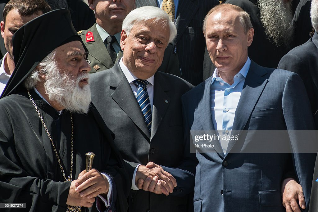 The President of the Russian Federation Vladimir Putin (R), the Greek President <a gi-track='captionPersonalityLinkClicked' href=/galleries/search?phrase=Prokopis+Pavlopoulos&family=editorial&specificpeople=4517908 ng-click='$event.stopPropagation()'>Prokopis Pavlopoulos</a> (C), the highest abbot of Mount Athos Pavlos of Megistis Lavras (L) in Mount Athos, Greece on May 28, 2016.