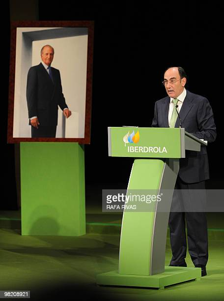 The president of the Spanish power company Iberdrola Jose Ignacio Sanchez Galan addresses shareholders as he stands next to a portrait of Spain's...