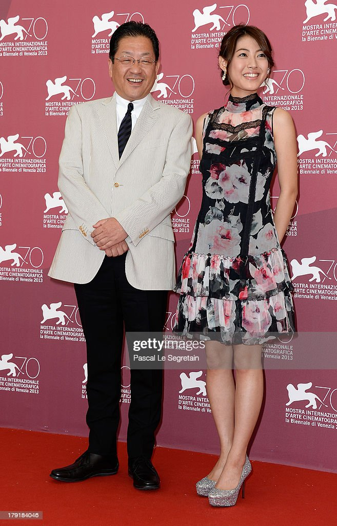 The president of the Studio Ghibli Koji Hoshino and actress Miori Takimoto attend 'The Wind Rises' Photocall during the 70th Venice International Film Festival at the Palazzo del Casino on September 1, 2013 in Venice, Italy.
