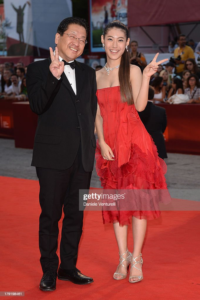 The president of the Studio Ghibli, Koji Hoshino and actress Miori Takimoto attends 'Kaze Tachinu' Premiere during the 70th Venice International Film Festival at Sala Grande on September 1, 2013 in Venice, Italy.