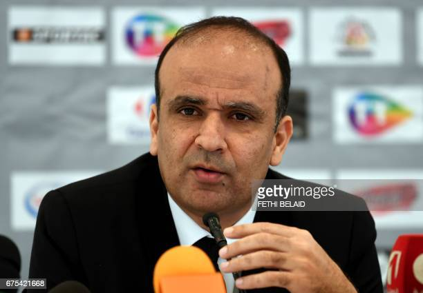 CORRECTION The President of the Tunisian football federation Wadii Jari speaks during a press conference with Tunisia's football team new head coach...