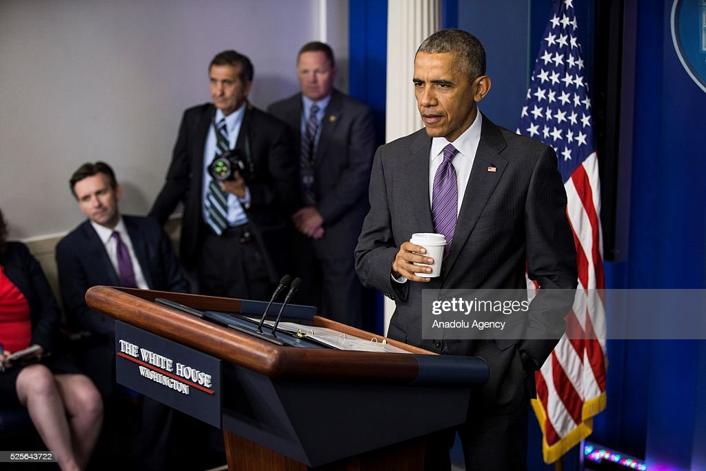 The President of the United States Barack Obama (R) makes a surprise stop to answer questions from student journalists from colleges all over the United States in the Brady Press Briefing Room of the White House in Washington, USA on April 28, 2016.