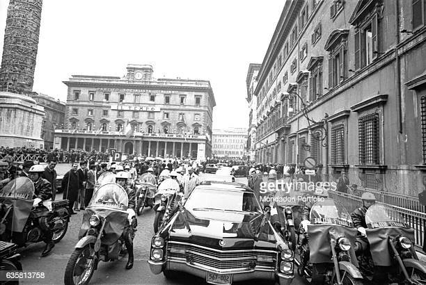 The President of the United States of America Richard Nixon's car being escorted by the police to Palazzo Chigi On the left the Column of Marcus...