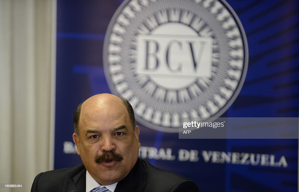 The president of the Venezuelan Central Bank, Nelson Merentes speaks during a press conference in Caracas on February 8, 2013. Venezuela said Friday it is devaluing its currency by 32 percent against the dollar. AFP PHOTO/ Leo RAMIREZ