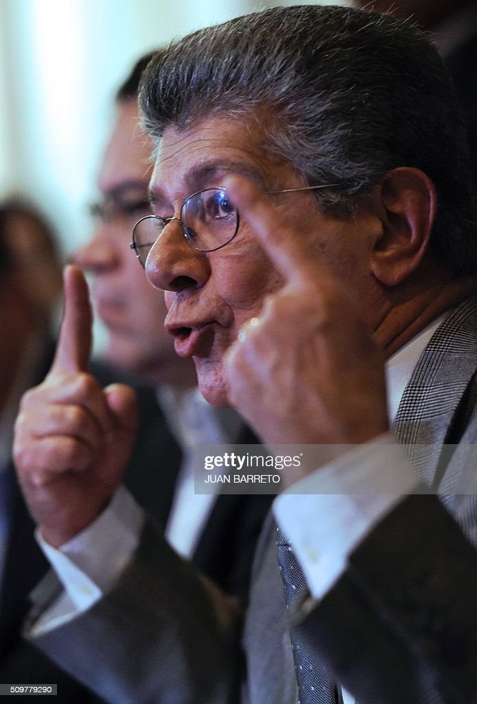 The president of the Venezuelan National Assembly, Henry Ramos Allup, talks during a press conference in Caracas on February 12, 2016. Venezuela's opposition Friday vowed speeded-up moves to oust President Nicolas Maduro after he defied lawmakers by decreeing a state of economic emergency through the crisis-hit country's high court. The maneuvers intensified a political standoff that has raised fears of unrest and deepening economic suffering in the oil-rich, violence-plagued South American state. The Supreme Court on Thursday overruled opposition from lawmakers by approving Maduro's decree to place the country in a 60-day state of economic emergency. Opposition lawmakers reacted with outrage, accusing Maduro of expanding economic policies that they say are ruining the country. AFP PHOTO / JUAN BARRETO / AFP / JUAN BARRETO