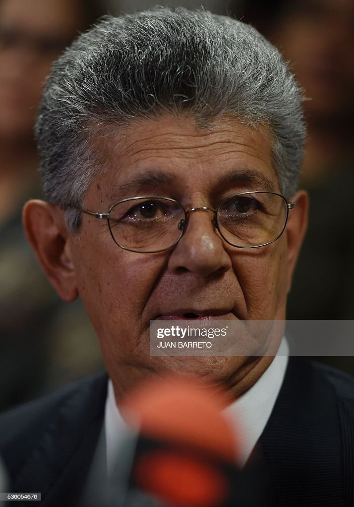 The president of the Venezuelan National Assembly, Henry Ramos Allup, offers a press conference in Caracas on May 31, 2016 after the Secretary General of the Organization of American States (OAS), Luis Almagro, called an 'urgent meeting' of the Permanent Council of the organization to discuss the political and institutional situation in Venezuela, invoking the Democratic Charter. In a 132-page letter to the organization's Permanent Council president, Almagro said Venezuela was experiencing 'an alteration of constitutional order,' which has adversely affected democracy in the country. Almagro requested that the 34 member states meet between June 10-20 to evaluate the Venezuelan government's commitment to democracy. BARRETO