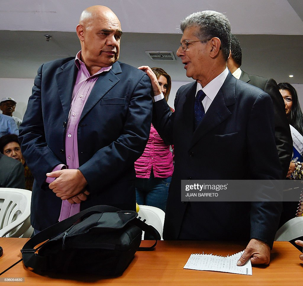 The president of the Venezuelan National Assembly, Henry Ramos Allup (R) and the secretary general of the opposition Democratic Unity Roundtable (MUD), Jesus 'Chuo' Torrealba, arrive to offer a press conference in Caracas on May 31, 2016 after the Secretary General of the Organization of American States (OAS), Luis Almagro, called an 'urgent meeting' of the Permanent Council of the organization to discuss the political and institutional situation in Venezuela, invoking the Democratic Charter. In a 132-page letter to the organization's Permanent Council president, Almagro said Venezuela was experiencing 'an alteration of constitutional order,' which has adversely affected democracy in the country. Almagro requested that the 34 member states meet between June 10-20 to evaluate the Venezuelan government's commitment to democracy. BARRETO