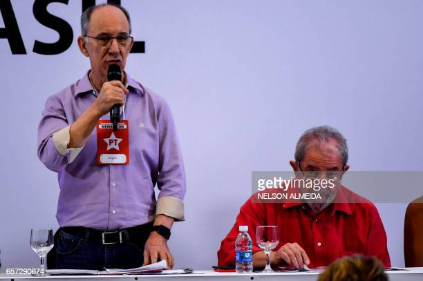 The president of the Workers Party Rui Falcao and former Brazilian president Luiz Inacio Lula da Silva attend the debate 'What Lava Jato has done to...