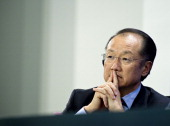 The President of the World Bank Jim Yong Kim attends a press meeting in the Chancellery on May 13 2014 in Berlin Germany German Chancellor Angela...