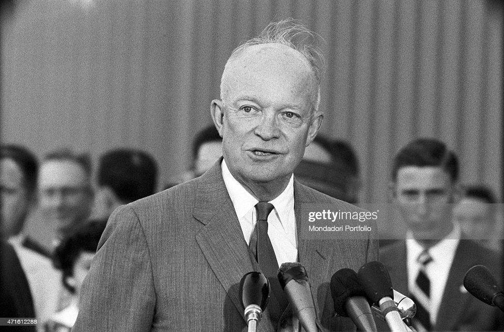 'The President of United States Dwight Eisenhower giving a speech at the airport during the Geneva Summit discussing issues about security German...