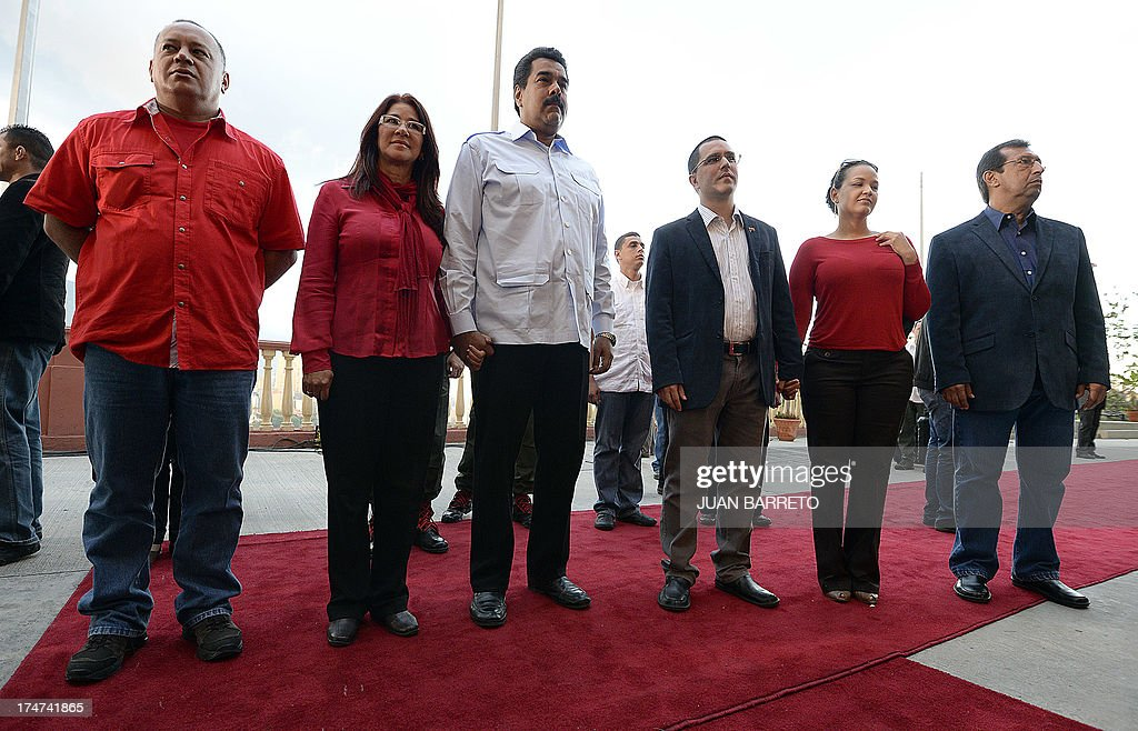 The President of Venezuelan National Assembly, Diosdado Cabello, Firts Lady Cilia Flores, Venezuelan President Nicolas Maduro, Venezuelan vice president Jorge Arreaza, his wife and daugther of the late President Hugo Chavez, Rosa Virginia Chavez and Barinas state Governor Adam Chavez, take part in a ceremony to commemorate Hugo Chavez's birthday anniversary, in Caracas, on July 28, 2013. AFP PHOTO/Juan Barreto