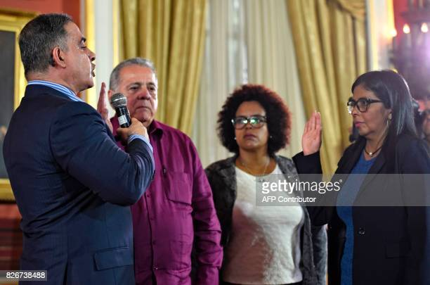 The president of Venezuela's Constituent Assembly Delcy Rodriguez swears in Venezuelan new Attorney General Tarek William Saab in Caracas on August 5...