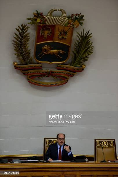 The president of Venezuela's National Assembly Julio Borges delivers a speech during the discussion for the activation of the Organization of...