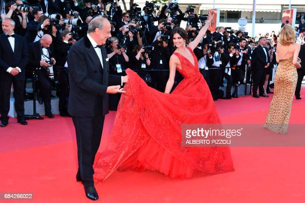 The president owner and founder of de Grisogono Fawaz Gruosi and Portuguese model Sara Sampaio pose as they arrive on May 17 2017 for the screening...